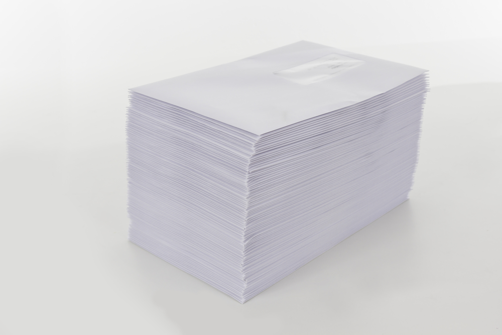Stack of DIN A5 Envelopes on a white Table